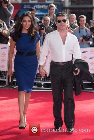 Lauren Silverman and Simon Cowell - A variety of stars were snapped as they took to the red carpet for...