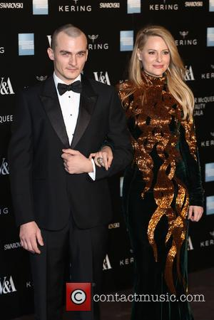 Rupert Friend and Aimee Mullins - A host of fashionable stars were photographed as they attended the Alexander McQueen: Savage...