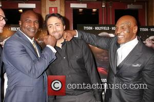 Evander Holyfield, Bert Marcus and Mike Tyson