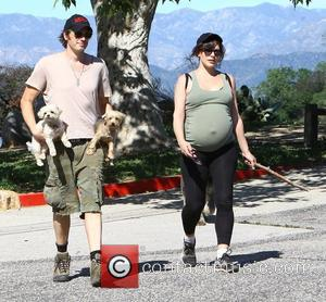 Milla Jovovich and Paul W.S. Anderson - Heavily pregnant Milla Jovovich and her husband Paul go for a walk with...
