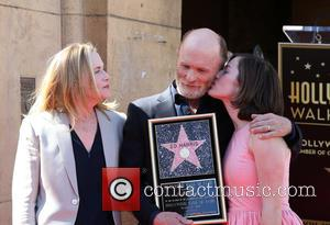 Amy Madigan, Ed Harris and Lily Dolores Harris