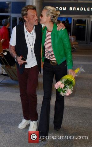 Jonny Hallyday and Laeticia Hallyday - Johnny Hallyday arrives at Los Angeles International (LAX) airport with his wife Laeticia and...
