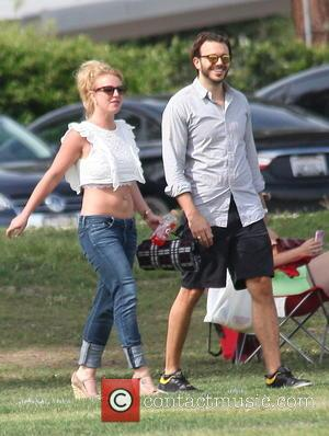 Britney Spears and Charlie Ebersol - American pop star Britney Spears was snapped out with her partner as they both...