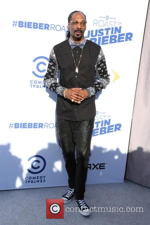 Snoop Lion and Snoop Dogg - A host of stars were snapped as they arrived for Comedy Central's Roast Of...