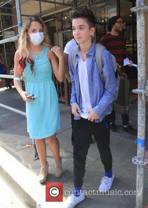 Daniel Seavey and Maddie Walker - American Idol contestants leave a medical building in Beverly Hills wearing surgical masks -...