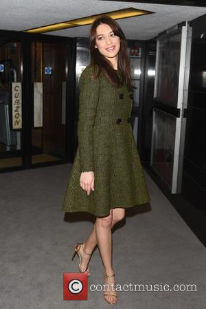 Olga Kurylenko and Guest - Dior and I - UK film premiere held at the Curzon Mayfair. - London, United...