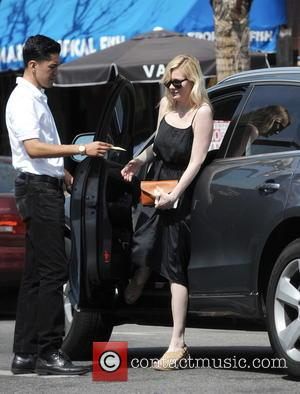 American actress Kirsten Dunst was spotted as she went out for lunch wearing a long black dress at Joan's on...
