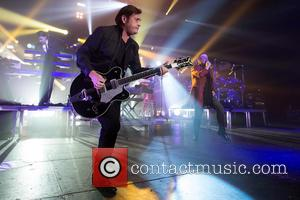 Charlie Burchill - Shots of Scottish 70's rock band Simple Minds as they performed live in concert at Liseberg in...