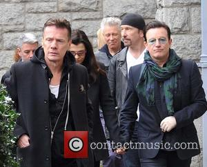 Larry Mullen, Ali Hewson, Adam Clayton, Edge and Bono