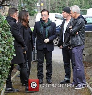 Larry Mullen, Ali Hewson, Bono, Edge and Adam Clayton