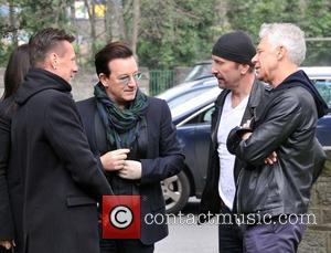 Larry Mullen, Bono, Edge and Adam Clayton