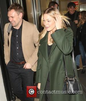 Shots of American country and pop singer LeAnn Rimes along with English singer songwriter David Gray as they both left...