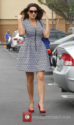 British glamour model turned actress Kelly Brook was snapped as she went out shopping with a friend to Costco wearing...