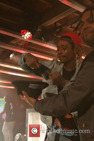 Shots of American rapper Wiz Khalifa as he performed a guest DJ set for Yahoo's #loudpack showcase at SXSW festival...