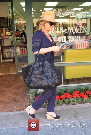Kathy Hilton - Kathy Hilton leaves a salon in Beverly Hills wearing a straw hat and wedge heel shoes -...