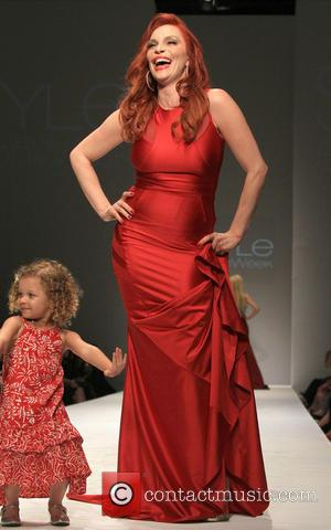 Carmit Bachar - SFW Go Red Celebrity Red Dress Show Benefiting the American Heart Association - Runway - Los Angeles,...