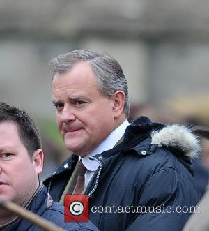 Hugh Bonneville - The cast of 'Downton Abbey' film a market scene for the new series - London, United Kingdom...