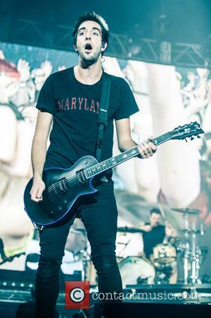Jack Barakat - Shots of American pop punk band All Time Low as they performed live on stage to a...