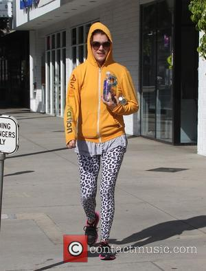 Kate Walsh - Kate Walsh out and about in West Hollywood wearing a mustard hoody and sunglasses - London, United...