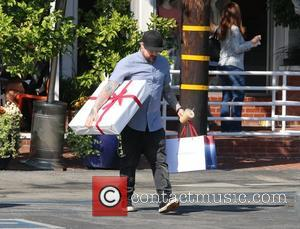 Benji Madden - Benji Madden leaves Fred Segal in West Hollywood carrying a large gift box and a shopping bag...