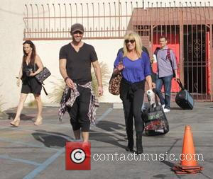 Tony Dovolani and Suzanne Somers - Celebrities arrive at the 'Dancing With The Stars' rehearsal studio - Los Angeles, California,...