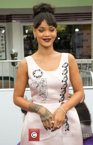 Rihanna Makes It A Billboard Double With Work