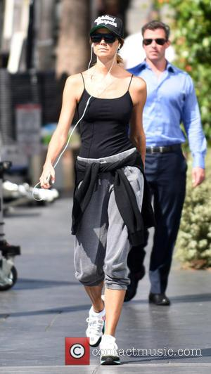 Stacy Keibler - Stacy Keibler goes for a morning power walk while listening to her iPod in Los Angeles -...