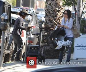 Sara Gilbert and Linda Perry - Sara Gilbert and Linda Perry out and about with their newborn baby in West...