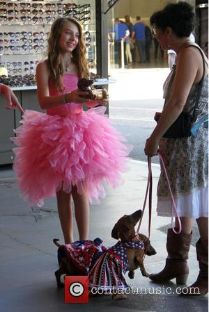 Caitlin Carmichael - Caitlin Carmichael dressed in a frilly pink tutu pats some dogs at The Grove in Hollywood -...