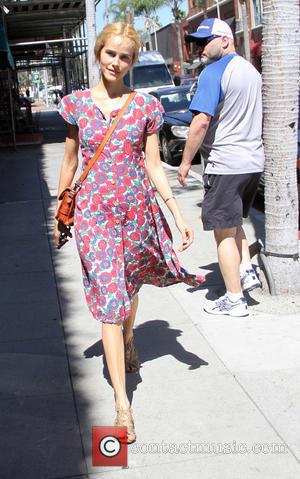 Isabel Lucas - Isabel Lucas goes shopping in Beverly Hills in a colourful floral dress - Los Angeles, California, United...