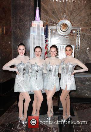 The Rockettes - The Rockettes light up the The Empire State Building in celebration of the opening night of the...