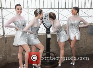 The Rockettes - The Rocketts Light the Empire State Building turquois in honor of the opening night of their band...