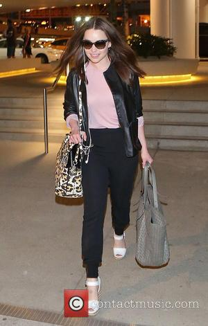 Emilia Clarke - Emilia Clarke departs from Los Angeles International (LAX) airport - Los Angeles, California, United States - Thursday...