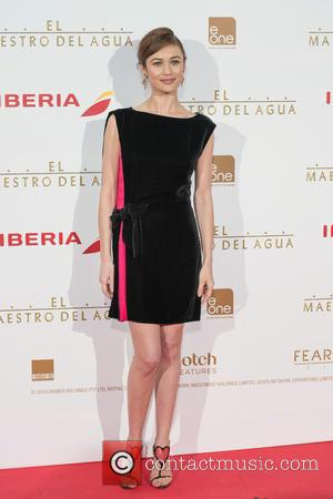Olga Kurylenko - Shots of a variety of stars as they arrived to the Madrid premiere of Russel Crowes latest...