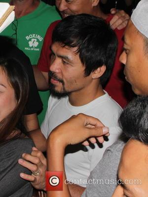 Manny Pacquiao - Professional boxer Manny Pacquiao sports a black eye as as he leaves the training camp at The...