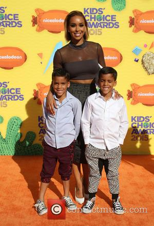 Gloria Govan, Carter Kelly Barnes and Isaiah Michael Barnes - A host of stars were snapped as they arrived for...