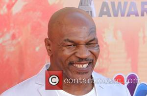 Mike Tyson - A variety of stars were photographed as they attended the 2nd Annual iHeartRadio Music Awards which were...