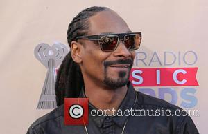 Snoop Lion and Snoop Dogg - A variety of stars were photographed as they attended the 2nd Annual iHeartRadio Music...
