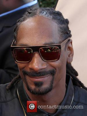 Trooper Who Posed With Snoop Dogg Sues Bosses