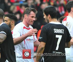 Jamie Carragher and Luis Suarez