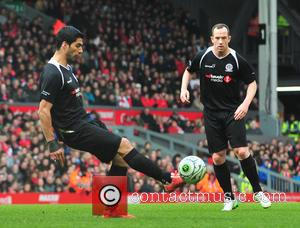 Luis Suarez and Charlie Adam