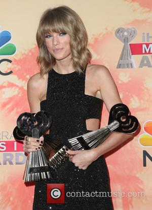Taylor Swift and Taylor Swift - 2nd Annual iHeartRadio Music Awards_Press Room at Shrine Auditorium and Expo Hall - Los...