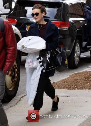 Snaps of English actress Carey Mulligan as she was out and about carrying some clothes in New York City, New...
