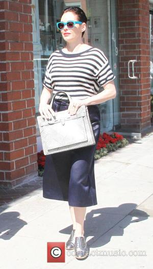 Rose McGowan - Rose McGowan wearing a stripped top and knee length black leather shorts, running errands in Beverly Hills...