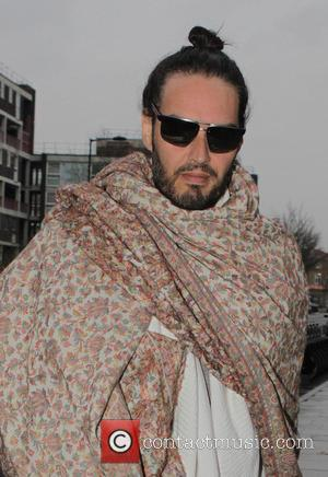 Shots of English comedian and activist Russell Brand as he arrived to The Proud Archivist dressed as the new messiah....