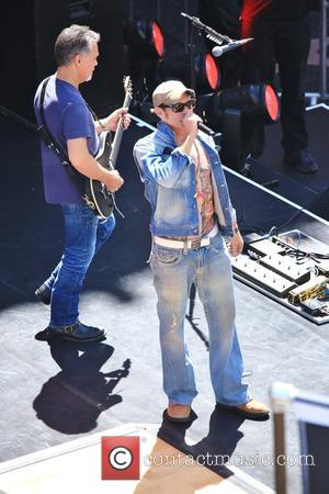 Van Halen, David Lee Roth and Eddie Van Halen - Van Halen rocks Hollywood Blvd during a sound check rehearsal...