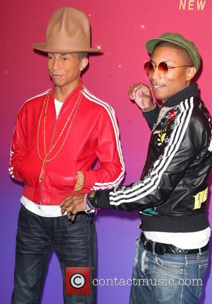 Pharrell Williams - Pharrell Williams unveil his wax figure at Madame Tussauds in New York at Madame Tussauds - New...
