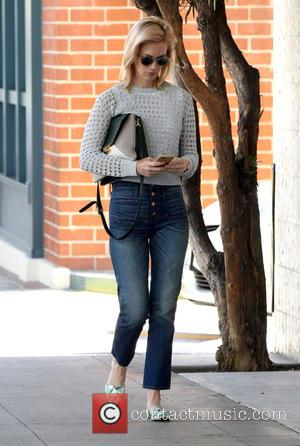 January Jones - January Jones out and about running errands in Beverly Hills this afternoon wearing a white crochet jumper,...