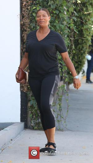 Shots of American rapper, actor and TV producer Queen Latifah as she arrived at a workout session wearing no make-up...