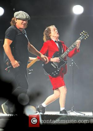 Angus Young, Brian Johnson and Ac/dc